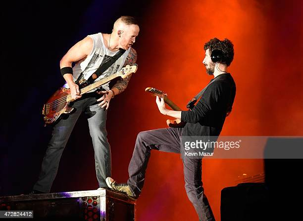 Musicians Dave Farrell and Brad Delson of Linkin Park performs onstage during Rock In Rio USA at the MGM Resorts Festival Grounds on May 9 2015 in...