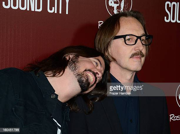 Musicians Dave Grohl and Butch Vig arrive at the Premiere Of Sound City at ArcLight Cinemas Cinerama Dome on January 31 2013 in Hollywood California