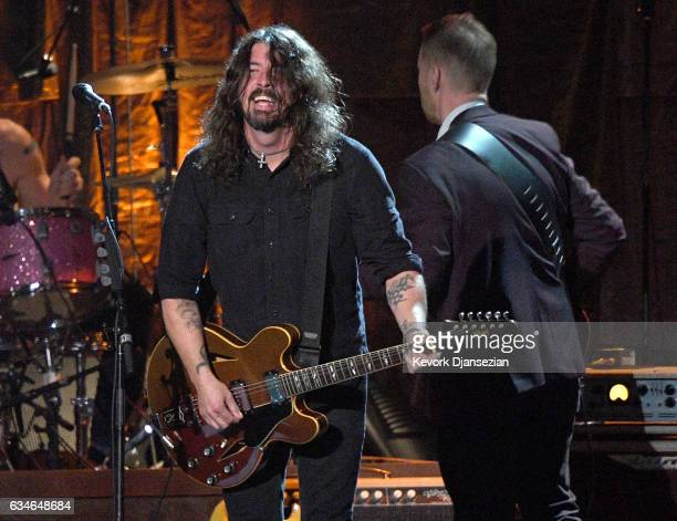 Musicians Dave Grohl and Chris Shiflett of the Foo Fighters perform onstage during MusiCares Person of the Year honoring Tom Petty at the Los Angeles...