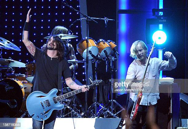 Musicians Dave Grohl and Nate Mendel of the Foo Fighters perform onstage at the 2012 MusiCares Person of the Year Tribute to Paul McCartney held at...