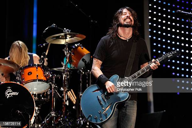 Musicians Dave Grohl and Taylor Hawkins of the Foo Fighters perform at The 2012 MusiCares Person of The Year Gala Honoring Paul McCartney at Los...