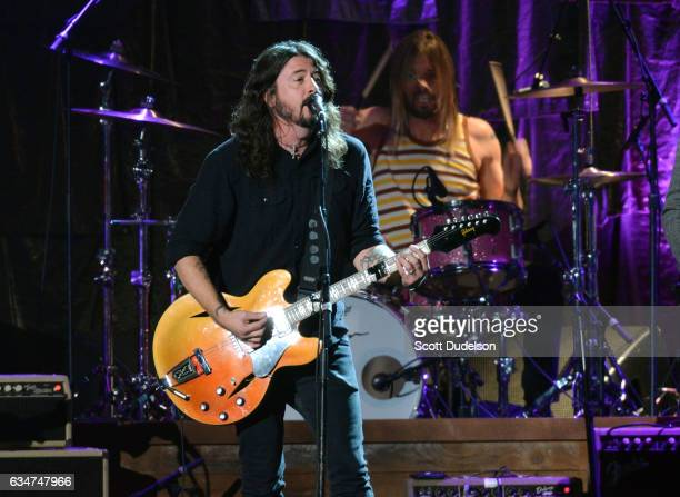 Musicians Dave Grohl and Taylor Hawkins of The Foo Fighters perform onstage during the 2017 MusiCares Person of the Year event on February 10 2017 in...