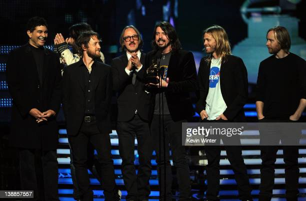 Musicians Dave Grohl Pat Smear, Taylor Hawkins Chris Shiflett and Nate Mendel accept the award for 'Best Rock Peformance' onstage at the 54th Annual...