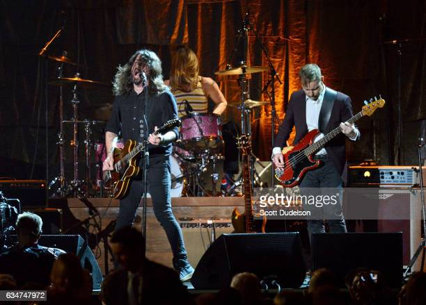 Musicians Dave Grohl Tayler Hawkins and Nate Mendel of The Foo Fighters perform onstage during the 2017 MusiCares Person of the Year event on...