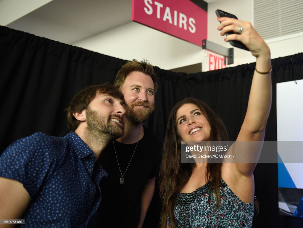Musicians Dave Haywood, Charles Kelley, and Hillary Scott of Lady Antebellum pose for a selfie during the 52nd Academy Of Country Music Awards Cumulus/Westwood One Radio Remotes at T-Mobile Arena on March 31, 2017 in Las Vegas, Nevada.