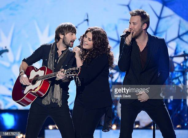Musicians Dave Haywood Hillary Scott and Charles Kelley of Lady Antebellum perform onstage during the 2012 American Country Awards at the Mandalay...