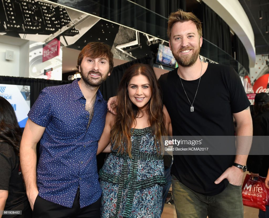 Musicians Dave Haywood (2nd L), Hillary Scott (2nd R), and Charles Kelley (R) of Lady Antebellum attend the 52nd Academy Of Country Music Awards Cumulus/Westwood One Radio Remotes at T-Mobile Arena on March 31, 2017 in Las Vegas, Nevada.