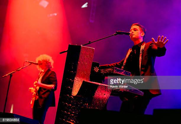 Musicians Dave Keuning and Brandon Flowers of The Killers perform onstage during the grand opening of TMobile Arena on April 6 2016 in Las Vegas...
