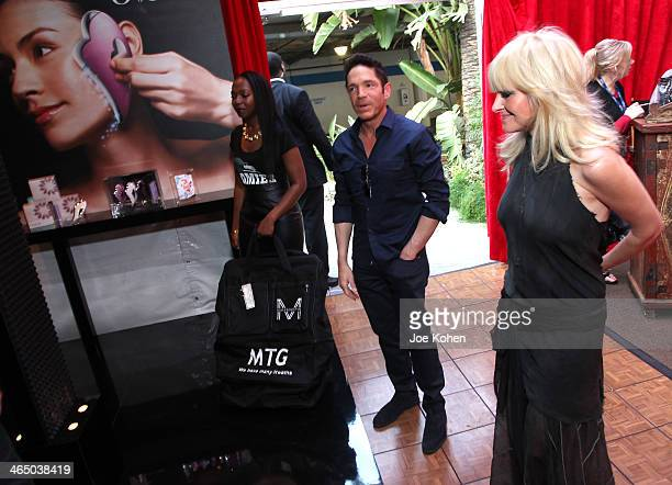Musicians Dave Koz and Mindi Abair attend the GRAMMY Gift Lounge during the 56th Grammy Awards at Staples Center on January 25 2014 in Los Angeles...