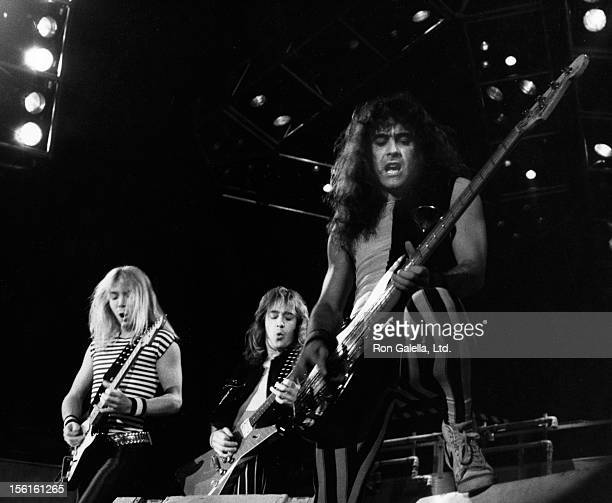 Musicians Dave Murray Adrian Smith and Steve Harris of Iron Maiden perform in concert on August 25 1983 at the Nassau Coliseum in Uniondale New York