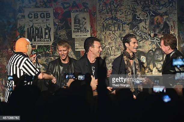 Musicians Dave Navarro Chris Cheney Stephen Perkins and Perry Farrell of Jane's Addiction and Gerald Casale of Devo speak onstage during the CBGB...