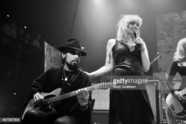 Musicians Dave Navarro of the band Jane's Addiction and Courtney Love of the band Hole perform onstage during the Above Ground concert benefiting...