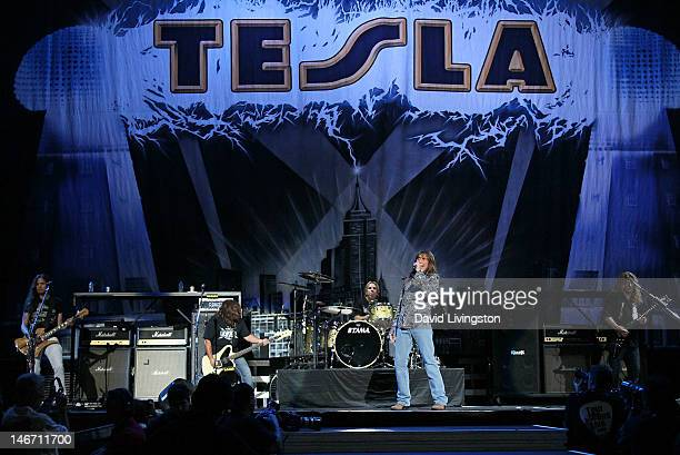 Musicians Dave Rude Brian WheatTroy Luccketta Jeff Keith and Frank Hannon of Tesla perform on stage at Staples Center on June 22 2012 in Los Angeles...