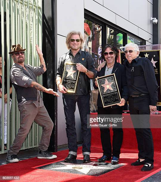 Musicians Dave Stewart Daryl Hall John Oates and music executive Jerry Greenberg attend the ceremony honoring Daryl Hall and John Oates with a star...