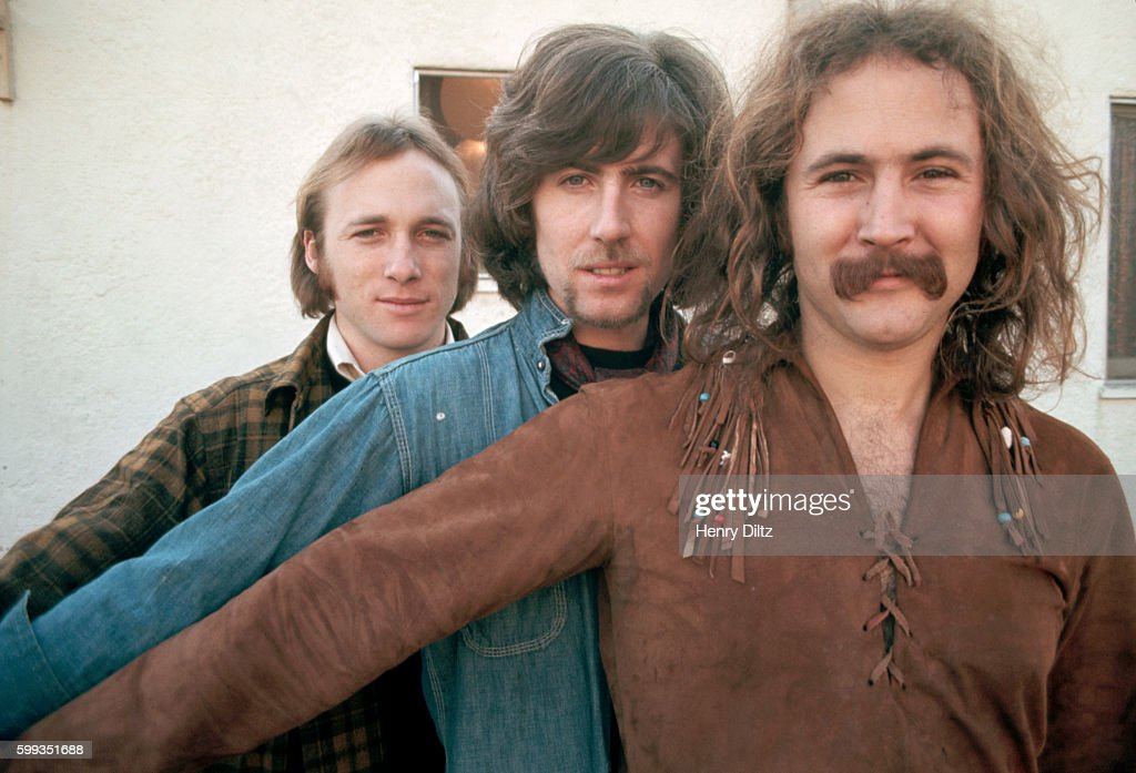 Musicians David Crosby (front), Graham Nash (center), and Stephen Stills (back) stand together. The rock group Crosby, Stills, and Nash were formed in the late sixties from members of The Hollies, The Byrds, and Buffalo Springfield. CSN collaborated with Neil Young occasionally, and racked up many hits in the sixties and seventies.