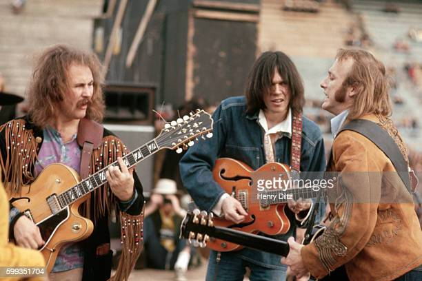 Musicians David Crosby Neil Young and Stephen Stills performing in San Diego The rock group Crosby Stills and Nash were formed in the late sixties...