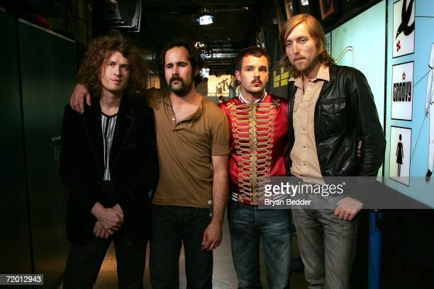 Musicians David Keuning Ronnie Vannucci Brandon Flowers and Mark Stoermer of the band The Killers make an appearance on MTV's Total Request Live at...