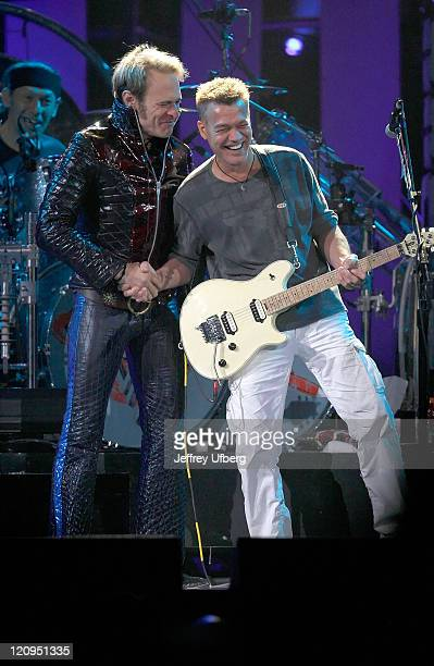 Musicians David Lee Roth and Eddie Van Halen perform on stage during their Van Halen concert May 13, 2008 in East Rutherford, New Jersey.