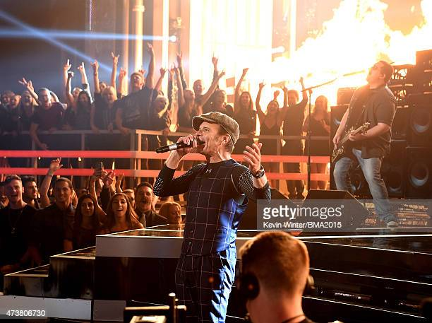 Musicians David Lee Roth and Wolfgang Van Halen of Van Halen perform onstage during the 2015 Billboard Music Awards at MGM Grand Garden Arena on May...