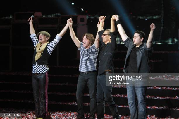 Musicians David lee Roth, Eddie, Alex and Wolfgang Van Halen are shown lined up at the end of their live concert appearance with Van Halen on March...