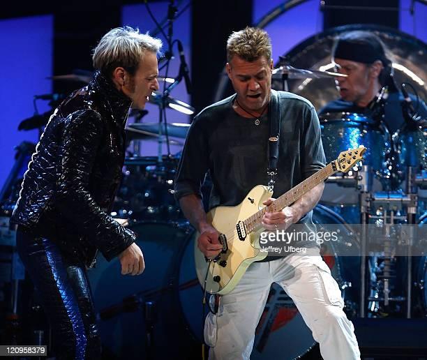 Musicians David Lee Roth Eddie Van Halen and Alex Van Halen perform during the Van Halen concert May 13 2008 in East Rutherford New Jersey