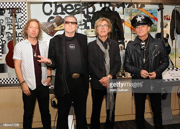 Musicians Daxx Nielsen Rick Nielsen Tom Petersson and Robin Zander pose before An Evening With Cheap Trick at The GRAMMY Museum on September 12 2013...