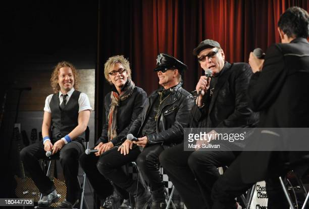 Musicians Daxx Nielsen Tom Petersson Robin Zander Rick Nielsen and Vice President of the GRAMMY Foundation Scott Goldman onstage during An Evening...