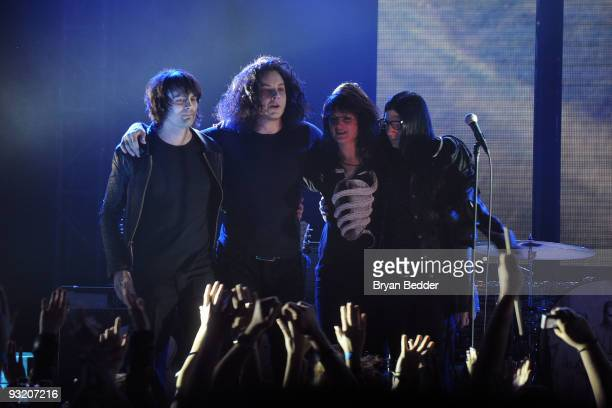 Musicians Dean Fertita Jack White Alison Mosshart and Jack Lawrence of The Dead Weather perform onstage at the 2009 mtvU Woodie Awards at Roseland...