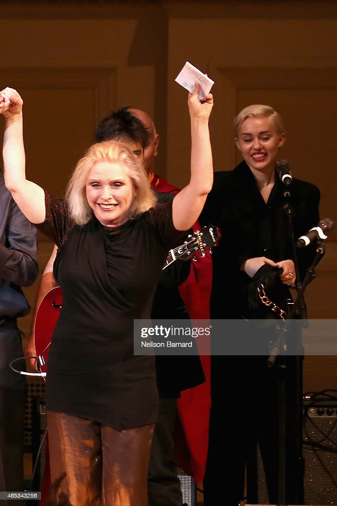 Musicians Debbie Harry (L) and Miley Cyrus perform on stage at the Tibet House Benefit Concert 2015 at Carnegie Hall on March 5, 2015 in New York City.