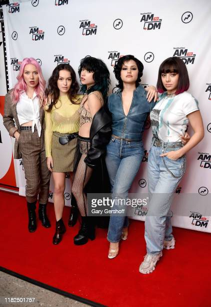 Musicians Deborah Knox-Hewson, Georgia Somary, Chloe Chaidaz and Gabbriette Bechtel of Nasty Cherry with Charli XCX visit BuzzFeed's AM To DM on...