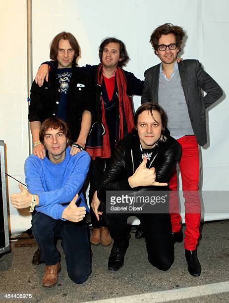 Musicians Deck d'Arcy Christian Mazzalai Laurent Brancowitz and Thomas Mars of Phoenix and Win Butler of Arcade Fire pose backstage during The 24th...