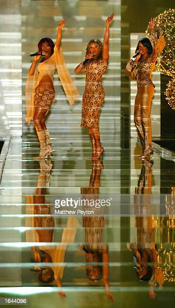 Musicians Destiny's Child perform at the Victoria Secret Fashion Show at the Lexington Avenue Armory November 14 2002 in New York City New York