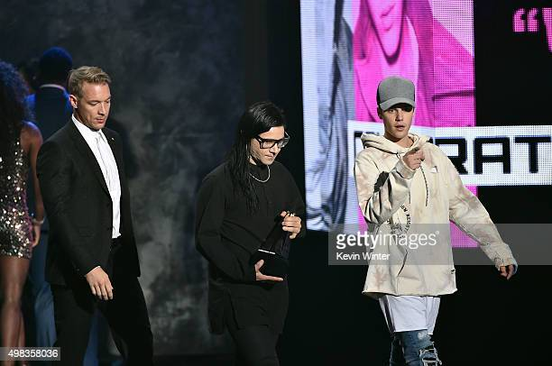 Musicians Diplo Skrillex and Justin Bieber accept Collaboration of the Year award for 'Where Are U Now' onstage during the 2015 American Music Awards...