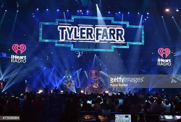 Musicians Dirk Weaver Mark Poiesz Tyler Farr and Gary Jannaman perform onstage during the 2015 iHeartRadio Country Festival at The Frank Erwin Center...