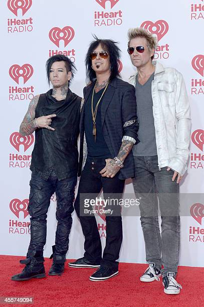 Musicians DJ Ashba Nikki Sixx and James Michael of SixxAM attend the 2014 iHeartRadio Music Festival at the MGM Grand Garden Arena on September 19...