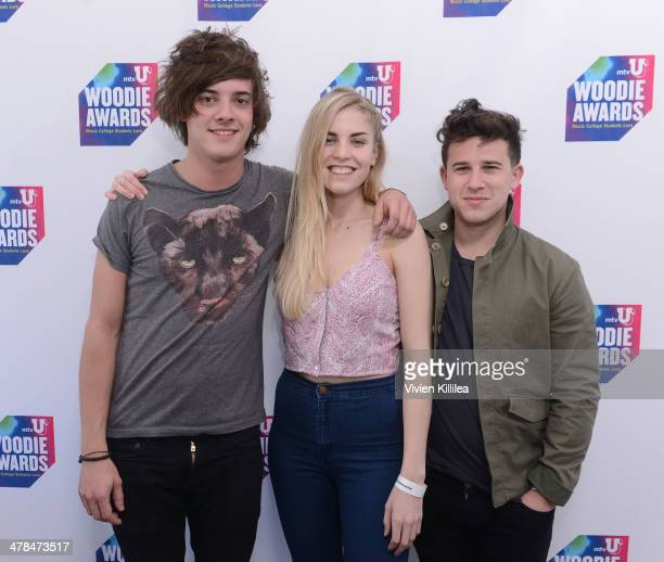 Musicians Dominic 'Dot' Major Hannah Reid and Dan Rothman of London Grammar attend the 2014 mtvU Woodie Awards and Festival on March 13 2014 in...