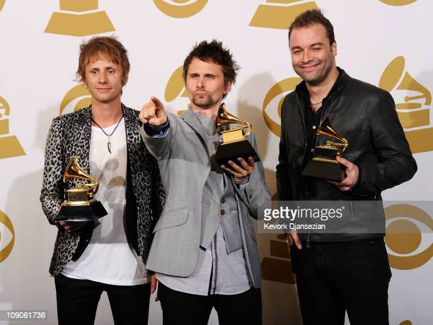 """Musicians Dominic Howard, Matthew Bellamy and Christopher Wolstenholme of Muse, winners of the Best Rock Album for """"The Resistance"""" pose in the press..."""