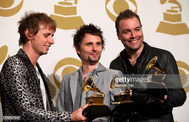 Musicians Dominic Howard, Matthew Bellamy and Christopher Wolstenholme of Muse pose in the press room at The 53rd Annual GRAMMY Awards held at...