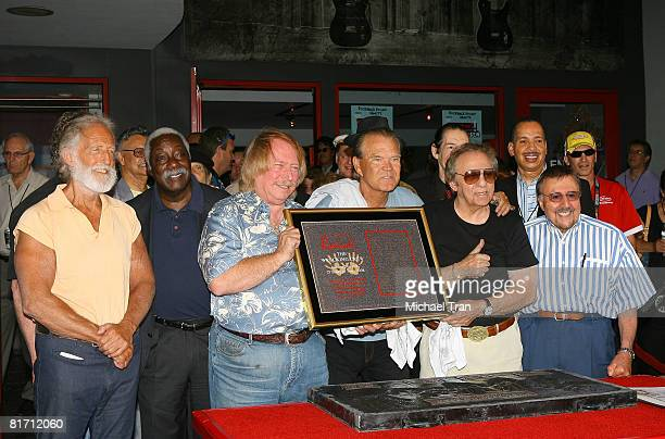 Musicians Don Randi Glen Cambell and Hal Blaine of The Wreaking Crew are inducted into Hollywood's RockWalk at the Guitar Center on June 25 2008 in...