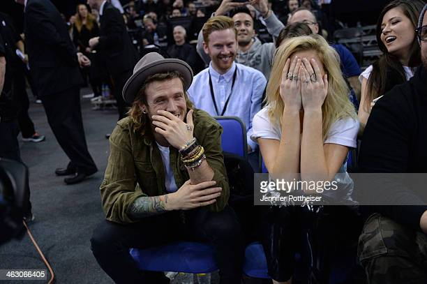 Musicians Dougie Poynter and Ellie Goulding takes in the game of the Brooklyn Nets against the Atlanta Hawks as part of the 2014 Global Games on...