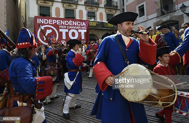 Musicians dressed as soldiers of the year 1714 perform during a tribute to the Catalan victims of War of Succession at the Fossar de les Moreres...