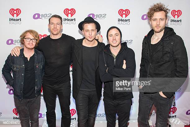 Musicians Drew Brown Zach Filkins Ryan Tedder Eddie Fisher and Brent Kutzle of the band OneRepublic attend Q102's Jingle Ball on December 10 2014 at...
