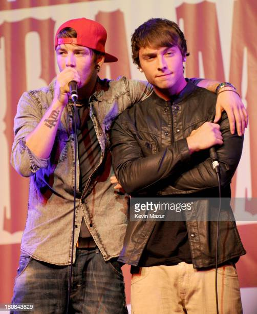 Musicians Drew Chadwick Wesley Stromberg of the band Emblem3 perform on stage at the 'TJ Martell Foundation's 14th Annual Family Day Honoring...