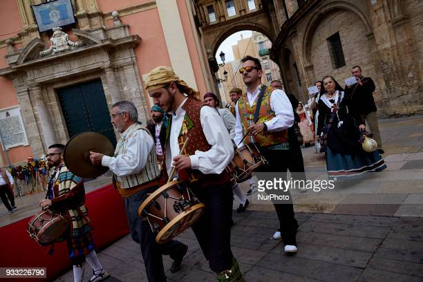 Musicians during a procession to present flowers to Saint Mary during Las Fallas Festival on March 17 2018 in Valencia Spain The Fallas is Valencias...