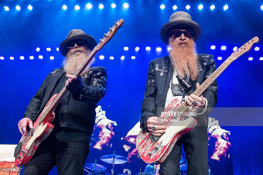 Musicians Dusty Hill (L) and Billy Gibbons of ZZ Top perform in concert at Cedar Park Center on April 30, 2015 in Cedar Park, Texas.