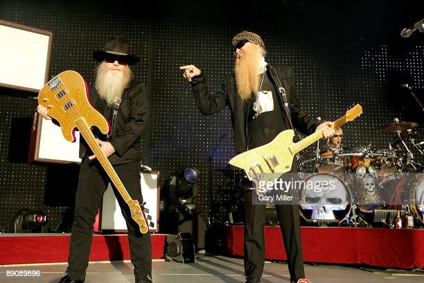 Musicians Dusty Hill Billy Gibbons and Frank Beard of ZZ Top perform in concert at The Cynthia Woods Mitchell Pavilion on July 17 2009 in The...