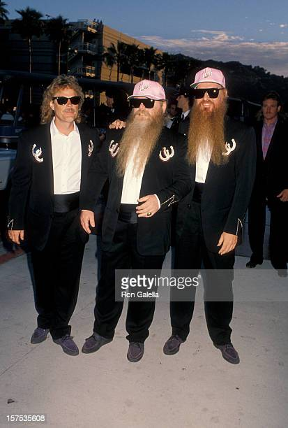 Musicians Dusty Hill Frank Beard and Billy Gibbons of ZZ Top attending the premiere of 'Back To The Future III' on May 21 1990 at the Universal...