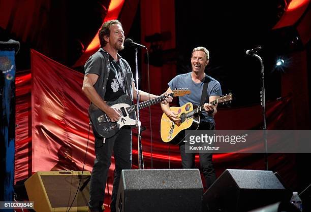 Musicians Eddie Vedder and Chris Martin perform onstage during the 2016 Global Citizen Festival In Central Park To End Extreme Poverty By 2030 at...