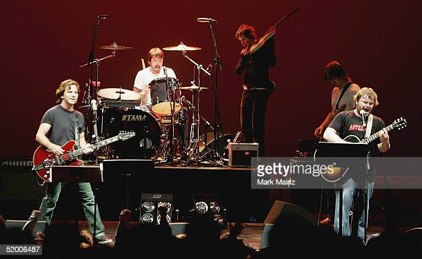 Musicians Eddie Vedder Dave Grohl Beck Josh Homme and Jack Black perform during the Music For Relief Concert at the Wiltern Theatre on January 17...