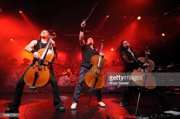 Musicians Eicca Toppinen Paavo Lotjonen and Perttu Kivilaakso of Apocalyptica perform onstage at the Nokia Theatre on August 24 2010 in New York City